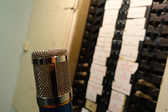 Voice Over Microphone looking at a switchboard