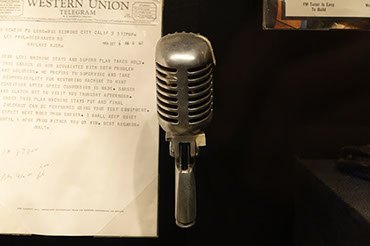Old Voice Over Microphone in Front of a Telegram